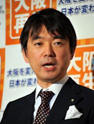 "Japan's Osaka Mayor Toru Hashimoto speaks to reporters in Tokyo in April 2012. The 42-year-old former corporate lawyer thinks Japan needs a dictatorship. He topped a list of politicians ""most suitable"" to lead Japan, well ahead of Prime Minister Yoshihiko Noda"