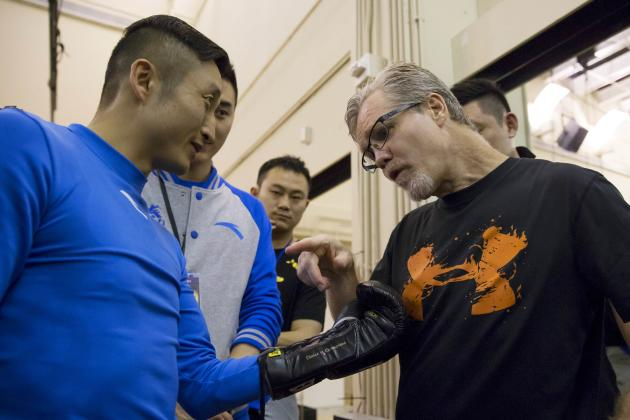 Double Olympic champion flyweight Zou Shiming (L) of China chats with trainer Freddie Roach during a work out in front of the media at the Venetian Macao hotel in Macau