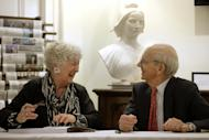United States Supreme Court Justice Stephen Breyer, right, speaks with artist Noelle Herrenschmidt, left, following a forum called From the Bench to the Sketchbook at the French Cultural Center, Monday, Feb. 13, 2017, in Boston. (AP Photo/Steven Senne)