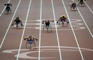 Britain's Hannah Cockroft (3rd L) races toward the finish line to win the women's 200m T34 final at the Paralympics on September 6. Interest and the focus on performance were signs that disabled sport had come of age, said the International Paralympic Committee governing body