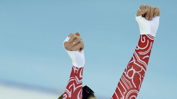 Olga Graf of Russia reacts after her women's 3000 meters speed skating race during the 2014 Sochi Winter Olympics