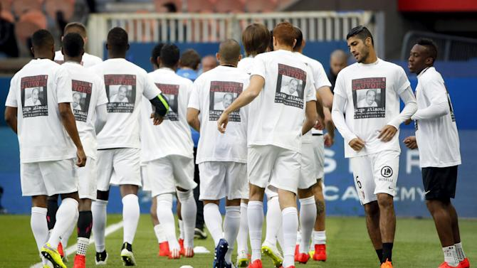 "Metz's players wearing shirts that read ""together we'll save Serge Atlaoui"" warm up before their their French Ligue 1 soccer match against Paris St Germain at Parc des Princes stadium in Paris"