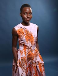 "FILE - In this Monday, Feb. 10, 2014 file photo, Lupita Nyong'o poses for a portrait at the 86th Oscars Nominees Luncheon, in Beverly Hills, Calif. Nyong'o is nominated for an Oscar for her performance by an actress in a supporting role for the film, ""12 Years a Slave."" The Academy Awards will be presented on Sunday, March 2, 2014. (Photo by Matt Sayles/Invision/AP, file)"