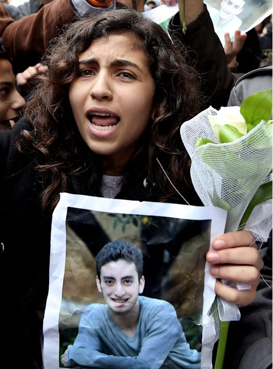 A Lebanese student of the private Hariri High School, named after a prominent assassinated Sunni leader, chants slogans as she holds a photo of 16-year-old Mohammed Shaar, who was one of seven people
