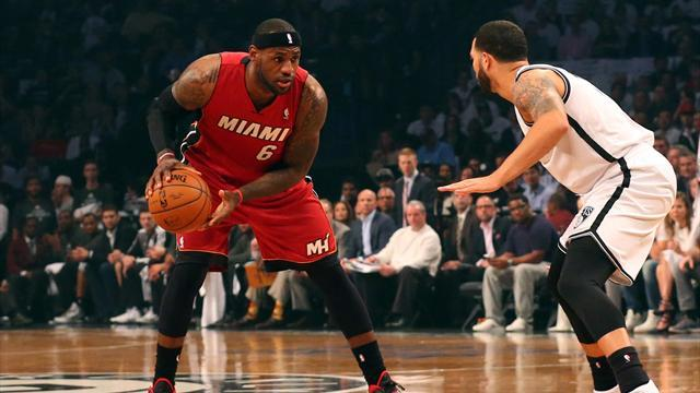Basketball - James scores 49 to lead Heat over Nets for two-game series lead