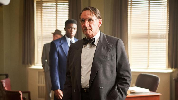 "This publicity film image released by Warner Bros. Pictures shows Chadwick Boseman, left, as Jackie Robinson and Harrison Ford as Branch Rickey in Warner Bros. Pictures' and Legendary Pictures' drama ""42,"" a Warner Bros. Pictures release. (AP Photo/Warner Bros. Pictures, D. Stevens)"