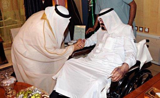 A Saudi Press Agency (SPA) photo released on November 28, 2012, shows King Abdullah bin Abdul Aziz receiving well-wishers at a Riyadh hospital. The 89-year-old monarch has left hospital nearly a month after undergoing back surgery, the royal court announced