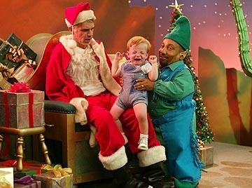 Billy Bob Thornton and Tony Cox in Miramax's Bad Santa