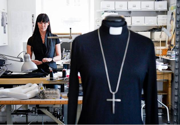 Swedish fashion designer Maria Sjoedin works on her Casual Priest collection at her studio in Haegersten, near Stockholm