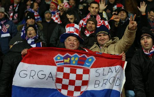 Croatia soccer supporters cheer their team during their World Cup qualifying payoff soccer match against Iceland, in Reykjavik, Iceland, Friday Nov. 15, 2013