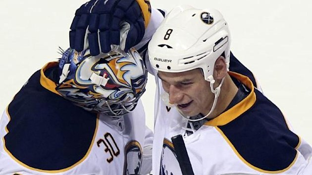 2011-12 NHL Buffalo Sabres goalie Ryan Miller (30) is congratulated by teammate Cody McCormick (8)
