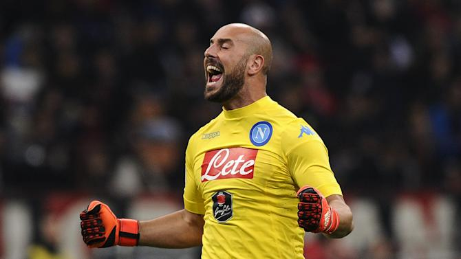 Napoli's goalkeeper Pepe Reina celebrates after teammate Lorenzo Insigne scores a goal against AC Milan during their Italian Serie A soccer match at the San Siro stadium in Milan