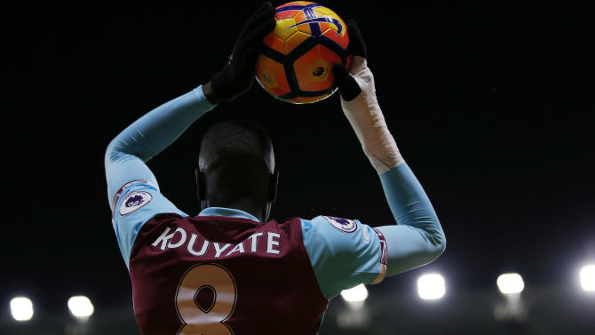 West Ham United's Cheikhou Kouyate takes a throw in