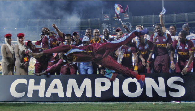 West Indies' Gayle jumps as his teammates watch after winning the World Twenty20 final cricket match against Sri Lanka in Colombo