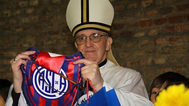 Argentine Cardinal Jorge Bergoglio poses with a jersey from the San Lorenzo soccer club, of which he is known to be a fan, in this undated handout photograph distributed by the club on March 13, 2013, after Bergoglio was elected as the new Pope (Reuters)