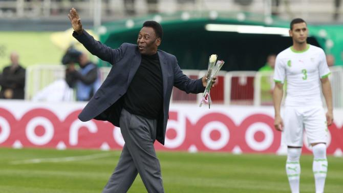 Brazilian soccer legend Pele waves during the international friendly soccer match between Algerian and Slovenia in Algiers