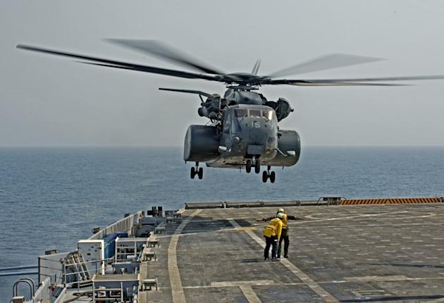 A MH53E helicopter takes off from the USS Ponce to conduct a mine clearance exercise in the Gulf on September 24, 2012. The US Navy said it is preparing to roll out a sea-based laser weapon capable of disabling small enemy vessels and shooting down surveillance drones