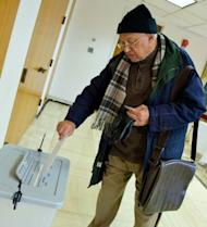 Dr. Salah Owelus casts his ballot at the Egyptian Embassy on December 12, 2012 in Washington. Expatriates began voting at embassies and consulates in 150 countries