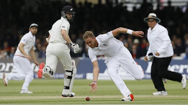 England's bowler Stuart Broad attempts to gather the ball  during play on the second day of the first Test match at Lord's cricket ground in London, Friday, May 22, 2015. (AP Photo/Kirsty Wigg