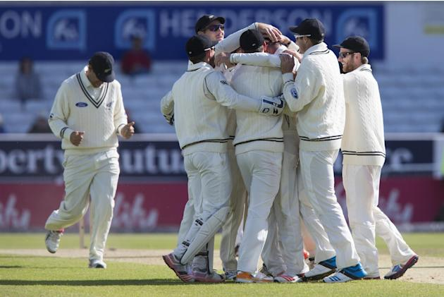 New Zealand players celebrate their test match win on the fifth day of the second Test match between England and New Zealand at Headingley cricket ground in Leeds, England, Tuesday, June 2, 2015. (AP