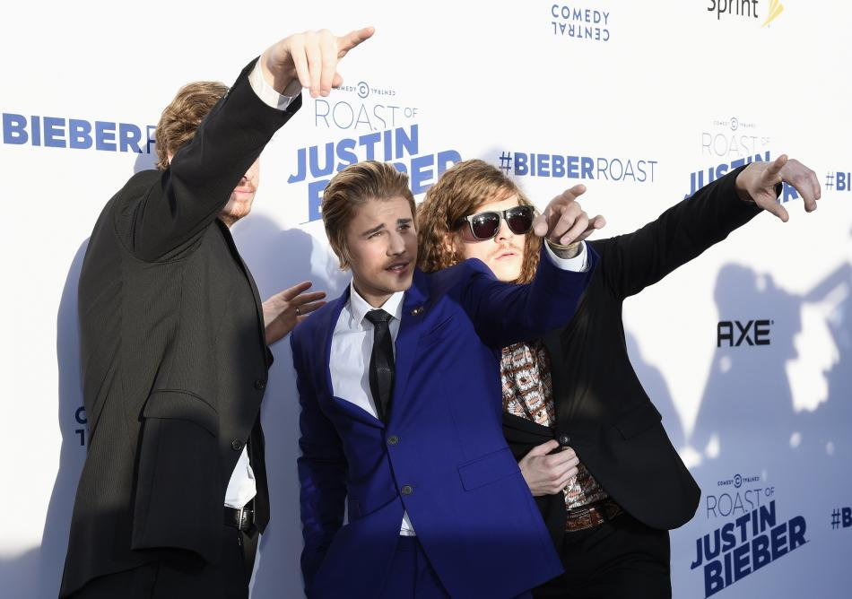 Anders Holm, Justin Bieber and Blake Anderson pose during Comedy Central Roast of Justin Bieber at Sony Studios in Culver City