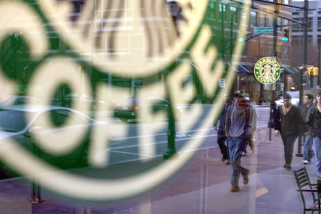 Pedestrians are reflected outside a Starbucks store in Atlanta.
