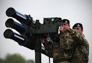 A Starstreak high velocity missile system, which could play a role in providing air security during the Olympics, is manned by members of the British Royal Artillery during a media demo in southeast London in May 2012. British residents living near London's Olympic Park launched legal action Thursday over government plans to station surface-to-air missiles on the roof of their rented flats