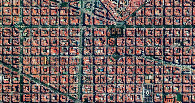 The Eixample District in Barcelona, Spain is characterised by its strict grid pattern and apartments with communal courtyards. (Benjamin Grant / Daily Overview / Amphoto Books / DigitalGlobe)