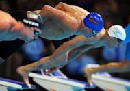 (L-R) Conor Dwyer, Ryan Lochte and Michael Phelps dive off the starting blocks at the start of the second semi-final heat of the men's 200m freestyle at the US Olympic swimming trials on June 26. Lochte edged Phelps by two-hundredths of a second in the semi-finals of the 200m free