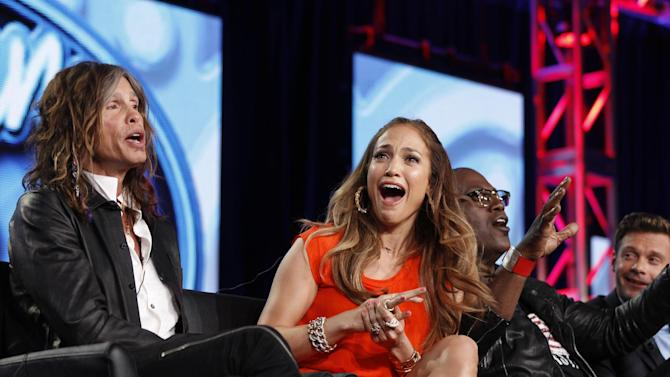 "FILE - In this Jan. 8, 2012 photo, ""American Idol"" judge Jennifer Lopez, center, reacts as fellow judge Steven Tyler, left, of Aerosmith makes a joke about wearing Lopez's pants as Randy Jackson and Ryan Seacrest are seen at right during the ""American Idol"" panel at the Fox Broadcasting Company Television Critics Association Winter Press Tour in Pasadena, Calif. ""American Idol"" is on the brink of a crisis, Thursday, July 12, 2012, as judge Steven Tyler is leaving, and fellow judge Jennifer Lopez is dithering about staying put. (AP Photo/Danny Moloshok, File)"