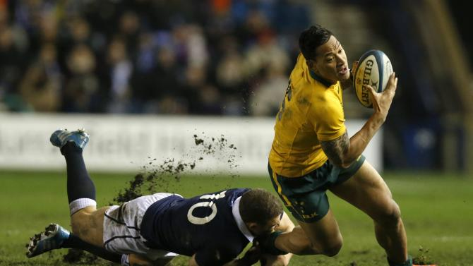 Australia's Israel Folau is tackled by Scotland's Duncan Weir during their rugby union international test match at Murrayfield Stadium in Edinburgh Scotland