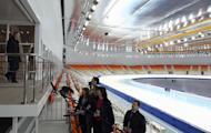 Russia's President Vladimir Putin (L) visits the Speed Skating centre 'Adler Arena' near the Black Sea city of Sochi, on February 7, 2013. A year before athletes converge on Sochi for the Winter Olympics, the Russian seaside city remains a vast construction site, with traffic choking the streets and locals bracing for another year of nonstop work to transform their landscape
