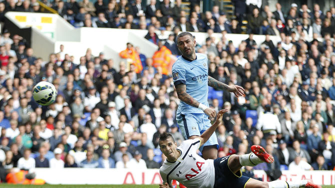 Football: Tottenham's Erik Lamela in action with Aleksander Kolarov