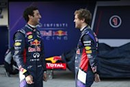 Red Bull Formula One drivers Sebastian Vettel (R) of Germany and Daniel Ricciardo of Australia smile after unveiling the new RB10 during the official presentation of the Red Bull Formula One Team 2014 at the Jerez racetrack in southern Spain January 28, 2014. REUTERS/Marcelo del Pozo