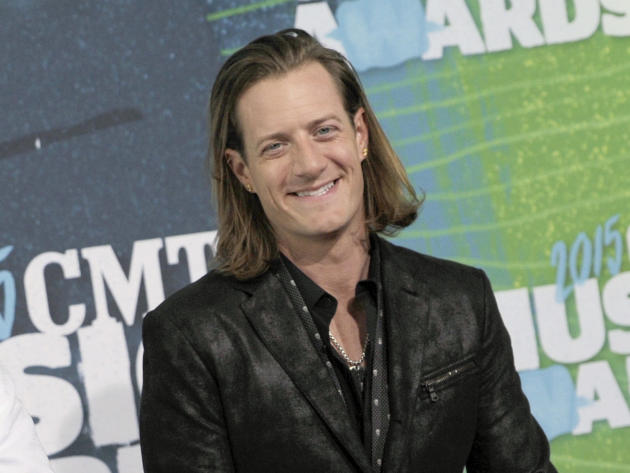FILE - In this June 10, 2015 file photo, Tyler Hubbard, of Florida Georgia Line, arrives at the CMT Music Awards in Nashville, Tenn. Hubbard married Idaho native Hayley Stommel in Sun Valley,  Idaho o
