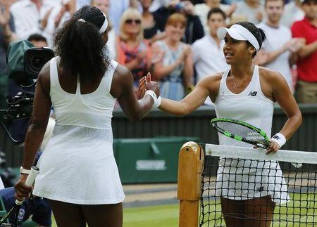 Serena Williams of the U.S.A. shakes hands with Heather Watson of Britain (R) after winning their match at the Wimbledon Tennis Championships in London