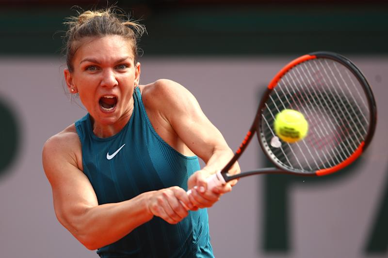Imperious Halep battles back to claim elusive first major
