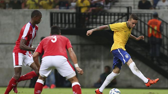 Luan of Brazil's Under-23 team kicks the ball during their friendly soccer match against Dominican Republic's Under-23 team in Manaus