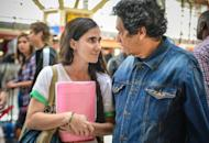 """Cuban blogger Yoani Sanchez talks to her husband, dissident Reinaldo Escobar, before departing from Havana's airport on February 17, 2013. Sanchez, 37, often criticizes the Cuban government in her """"Generation Y"""" blog"""