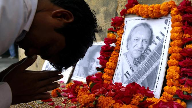 A student pays tribute to legendary Indian sitar player Ravi Shankar at the Bengali Tola Inter College, where Shankar had studied in Varanasi, India, Wednesday, Dec. 12, 2012. Shankar, who is credited with connecting the world to Indian music, died Tuesday in San Diego at the age of 92. (AP Photo/Rajesh Kumar Singh)