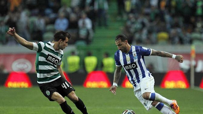 Porto's Ricardo Quaresma, right, challenges Sporting's Cedric Soares during the Portuguese league soccer match between Sporting and Porto at Sporting's Alvalade stadium, in Lisbon, Sunday, March 16, 2014