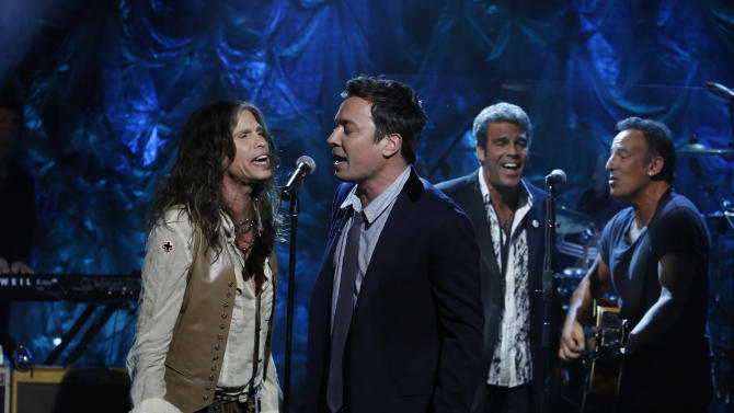 "In this photo provided by NBC, from left, Steven Tyler, Jimmy Fallon, Mark Rivera, and Bruce Springsteen, perform during ""Hurricane Sandy: Coming Together"" Friday, Nov. 2, 2012, in New York. Hosted by Matt Lauer, the event is heavy on stars identified with New Jersey and the New York metropolitan area, which took the brunt of this week's deadly storm. (AP Photo/NBC, Heidi Gutman)"