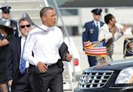 US President Barack Obama takes his coat off as he rushes to greet supporters upon arriving at Miami International Airport in Miami, Florida, on June 26. Obama, renowned as a champion fundraiser who piled up $750 million in 2008, warned supporters he would be outspent by his foe Mitt Romney in this year's election