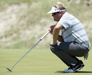 Carl Pettersson of Sweden lines up a putt during round one of the 94th PGA Championship, on August 9, on Kiawah Island, South Carolina. Pettersson, who had never broken 70 before in the PGA Championship, birdied three of his first four holes to take a one-shot lead after the first round