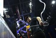 A worker peels off a protective plastic sheet from a mirror as preparations continue at the Tampa Bay Times Forum, Florida, ahead of the Repuplican National Convention. The US Republican and Democratic conventions have traditionally targeted television viewers above all -- but this year's will see an unprecedented effort to reach voters via social media