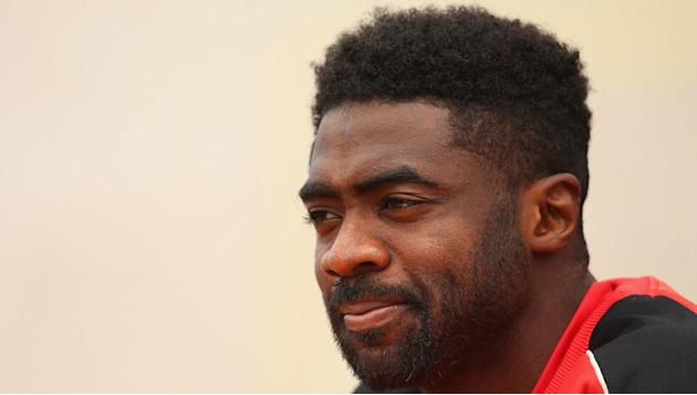 Kolo Toure Looks Rather Gloomy After Donning Celtic Shirt for the First Time
