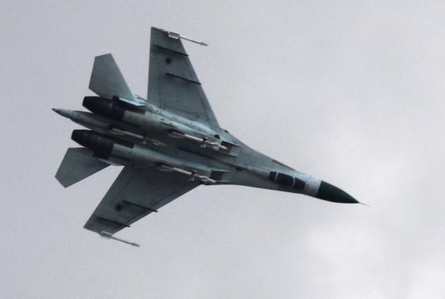 Ukrainian air force Su-27 fighter jet is in the sky outside Slovyansk, 160 kilometers (100 miles) from the Russian border, in eastern Ukraine, Tuesday, April 15, 2014. The Ukrainian government has launched an operation to uproot pro-Russia armed separatists who have seized government buildings in several cities in eastern Ukraine. (AP Photo/Alexander Ermochenko)
