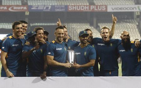 South Africa's players pose with their trophy after winning the Twenty20 international cricket series against India in Kolkata