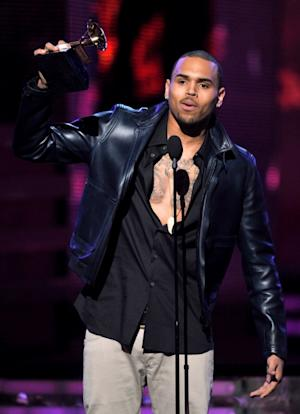 Chris Brown accepts the award for Best Rap Performance at The 54th Annual Grammy Awards at Staples Center in Los Angeles on February 12, 2012  -- Getty Images