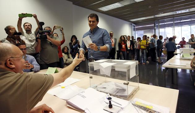Ciudadanos' party leader Rivera gestures before casting his ballot at a polling station in Barcelona